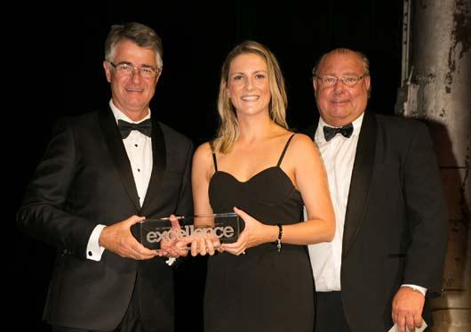 Cassandra Lantry Operations Manager receiving the Residential Property Management Team Award